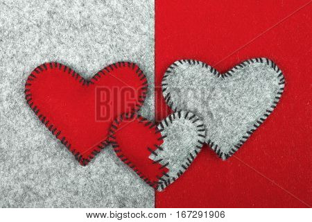 Three felt hearts on two different backgrounds valentines composition