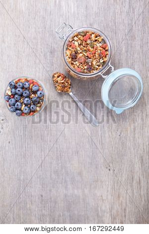 Paleo style granola with coconut yogurt with blueberries top view