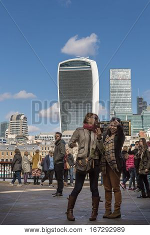 LONDON UK - MARCH 25 2016: Female tourists take a selfie onthe Southbank
