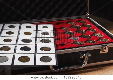 Box With Collectible Coins And A Page With Coins