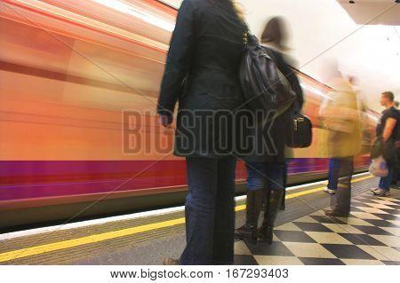 london underground busy platform blurry movement