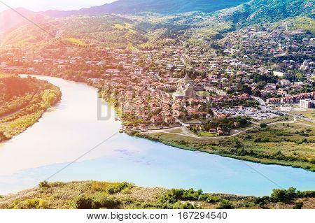 The picturesque landscape with the confluence of the rivers Kura and Aragvi (Mtskheta) in Georgia under the sun
