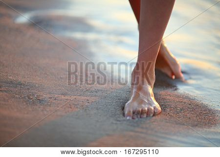 Beautiful Woman Legs On The Beach At Sunrise