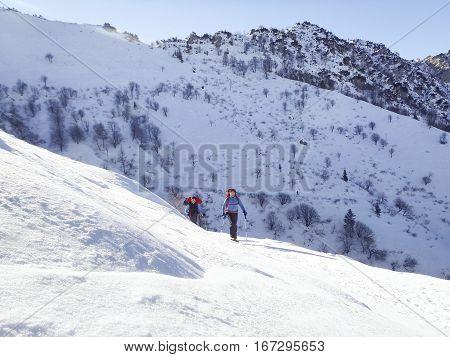 Cimadera Cima Fojorina Switzerland - February 1 2015: Walking people to mountain of Lombardy on the border between Italy and Switzerland.