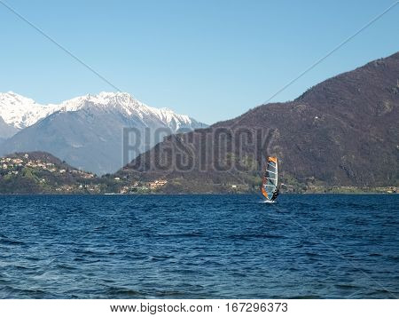 Pianello del Lario Como - Italy - March 28 2015: Windsurfer start from the beach and goes in search of strong winds towards the center of the lake.
