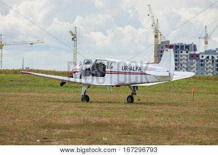 Kiev Ukraine - August 29 2010: Yakovlev Yak-18T light plane parked on the grass airfield