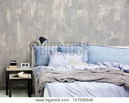 Bedroom interior with bed and nightstand on grungy wall background
