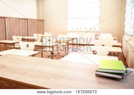 School teacher's desk with stack of books