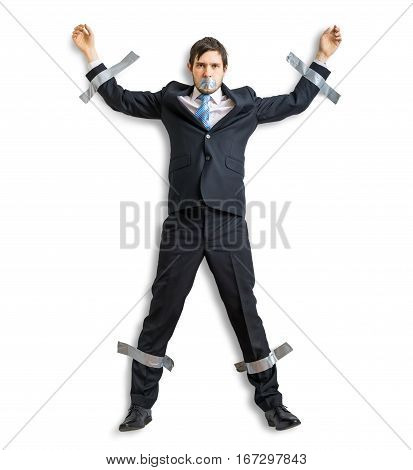 Businessman In Suit Is Taped To The Wall With Adhesive Tape. Iso