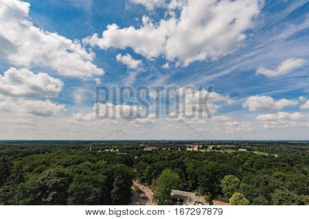 Large blue sky and flat land Netherlands white clouds