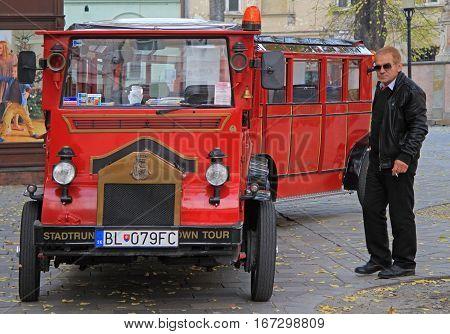 Bratislava, Slovakia - November 4, 2015: driver of retro carriage is smoking outdoor in Bratislava, Slovakia