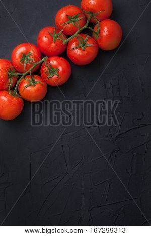 Red Fresh Organic Tomatoes On Black Concrete Background
