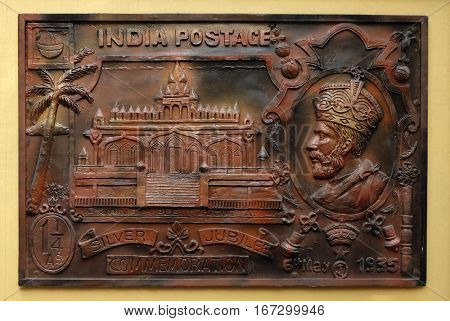 KOLKATA,INDIA - FEBRUARY 09, 2016: Celebrate silver jubilee of coronation of King George V(1935) issued stamp depicting Sri Sital Nath Jain Temple, Street bass relief on the wall of Jain Temple