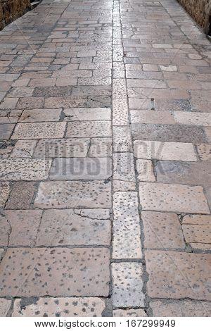 DUBROVNIK, CROATIA - DECEMBER 01: Stone blocks paved road in Dubrovnik, Croatia on December 01, 2015.