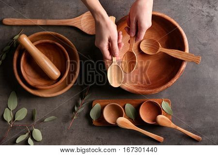 Female hands and dishware on grey background