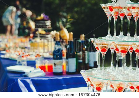 Pyramid glasses. Mount champagne on the table nature, wedding, catering
