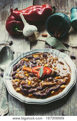 Chili con carne. Restaurant food concept with Mexican traditional dish stew in rustic setting