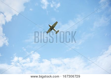 Airplane flies in the cloudy sky. Natural light and colors