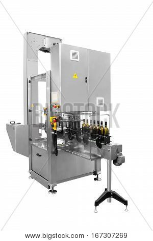 Single machine for labels sealing wine bottles isolated on white background