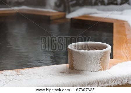 Japan natural mineral hot spring called onsen cover by snow in Japanese ryokan on the moutain okuhida takayama japan.