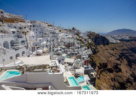 City of Fira hanging on the volcanic caldera at Santorini island in Greece. Santori belongs to the cyclades islands and is a famous summer white houses.