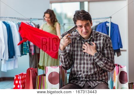 Man fed up with wife shopping in shop