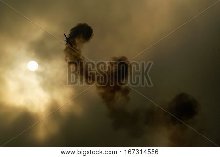 Aircraft fly to the sun on cloudy sky