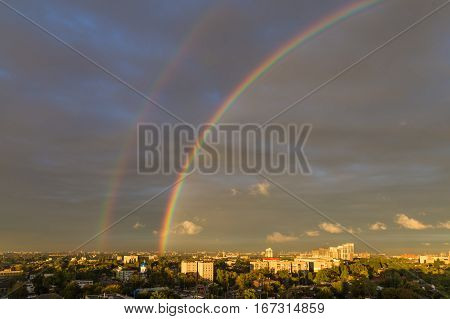 Rainbow over big industrial town - the urban landscape top view. Dnipro. Ukraine.
