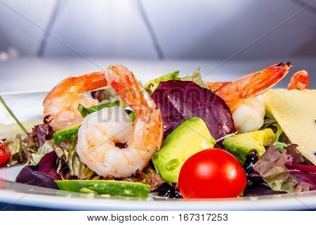 Shrimp coarsely. Shrimp salad, avocado, tomatoes and cheese.