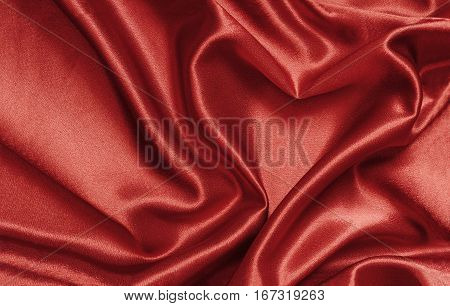 Red satin fabric draped in the form of heart for Valentine's day background