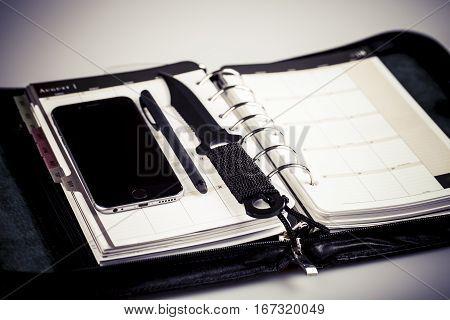 Murder Planning Concept - Calendar, Cellphone And Knife