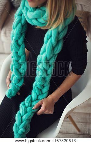 Wearing merino wool pastel colors scarf in the warm atmosphere.