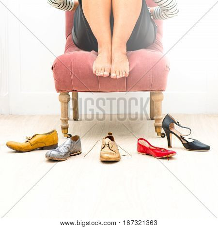 Woman On Barefoot Chair Undecided About What Shoes To Wear