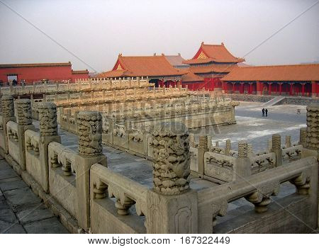photo from a morning misty background architectural structures of the Forbidden city, the largest Palace complex in the world, in the capital of China, in Beijing, the residence of the modern leaders of the country, as the source for design, printing.