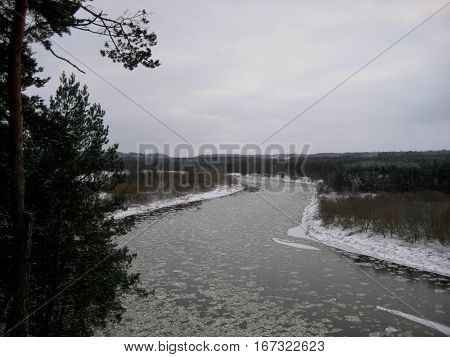 photo with the background of a winter landscape landscape with a prospect of the river gave, the frozen water of the river of large ice floes and the forests on the shores, as the source for design, fine art printing, photo shop, advertising