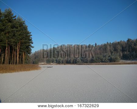 photo of sparkling ice on the surface of a frozen lake on the background of the natural landscape as the source for advertising, photo design, art print