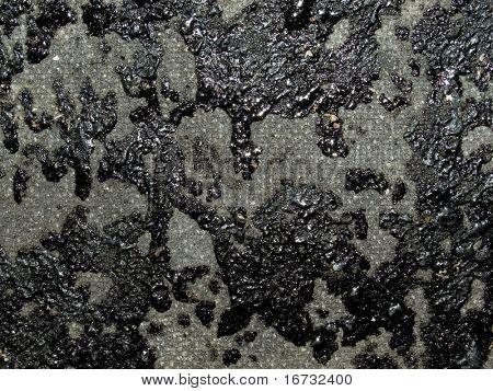 Black tar closeup texture background.