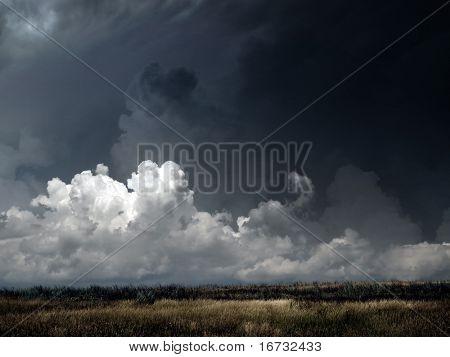 Autumnal field under dark thunderstorm sky.