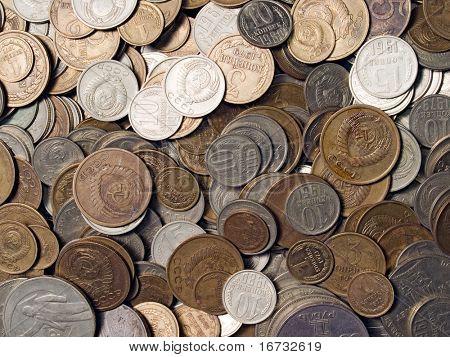Soviet obsolete coins closeup background.
