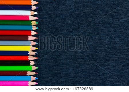 Black Background For Presentation With Vertical Colourful Border Of Pencils
