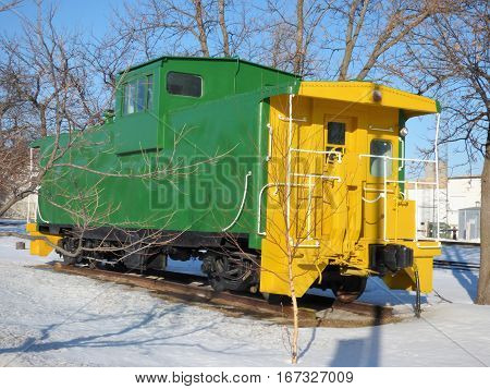 A abandoned caboose on display from the old railroad days.