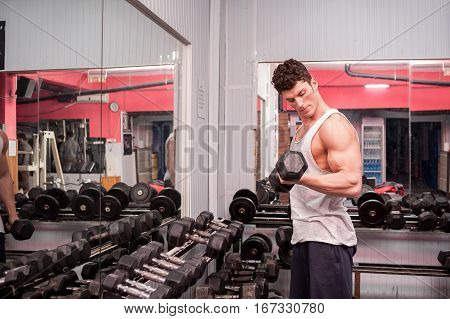 Man Looking At His Muscle Wile Exercising