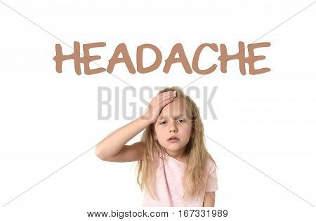 learning English language vocabulary school card with the word headache and sweet cute little female child touching her head suffering stress looking tired and sad isolated on white background