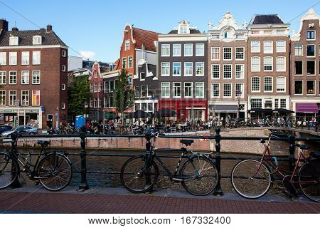 Amsterdam Netherlands - October 3 2016: Bicycles in front of Prinsengracht canal in Amsterdam Netherlands.
