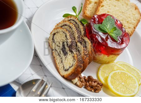 Delicious dessert consisting of cake roll with poppyseed and lemon
