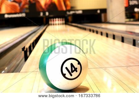 Game concept with Ball on bowling wooden floor against ten pins