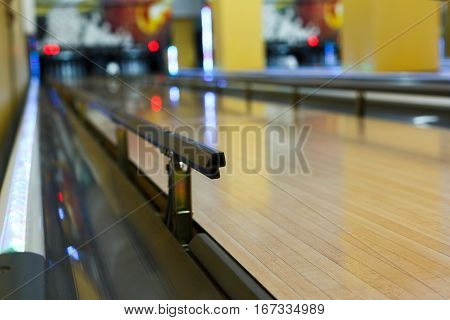 Bowling alley background. Lane with bumper rails closeup. Leisure activity club