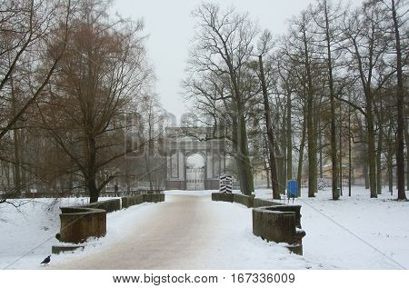 The fog the thaw and Orlov gate in the Catherine Park in Tsarskoye Selo
