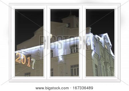 window with view to building decorated in New Year illumination. Happy New Year 2018