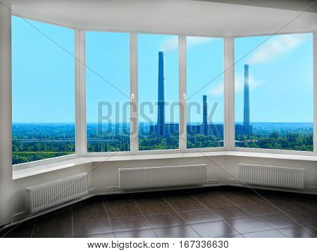 wide plastic windows overlooking the landscape with nature and pollution of environment by industry